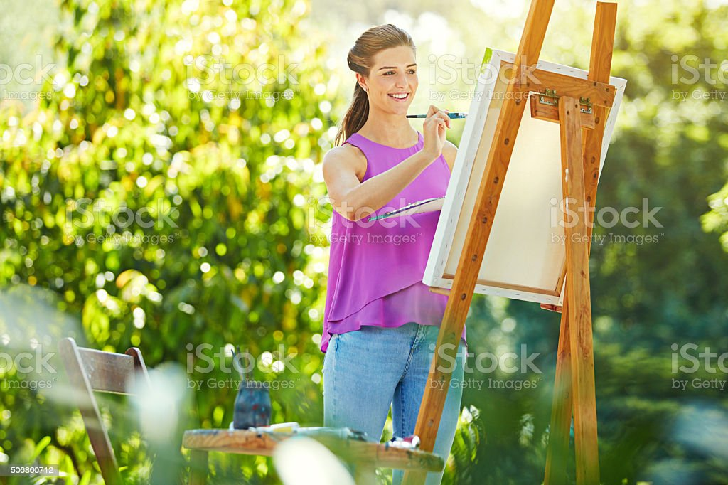 She finds painting to be therapeutic stock photo