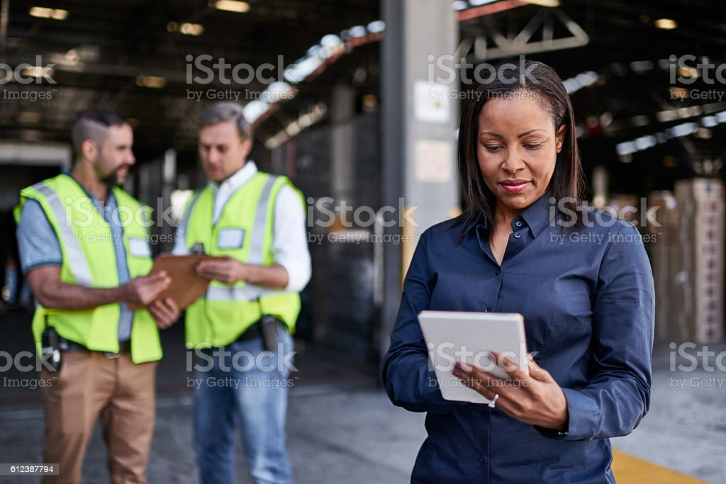 She gets the warehouse moving stock photo