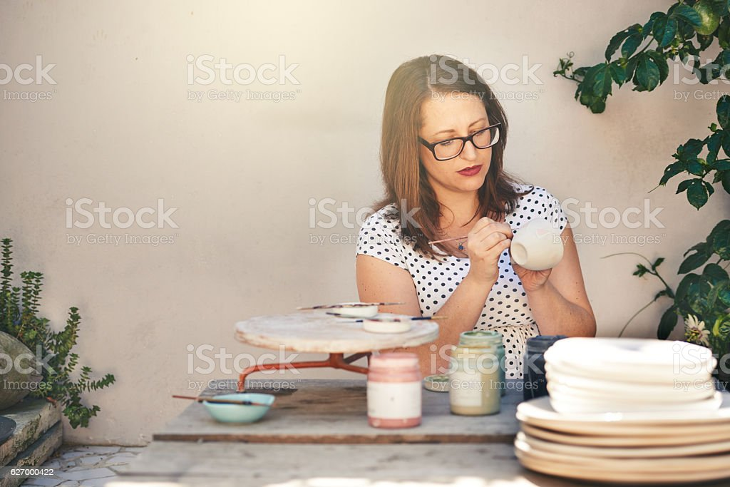 She gives every piece her undivided attention stock photo