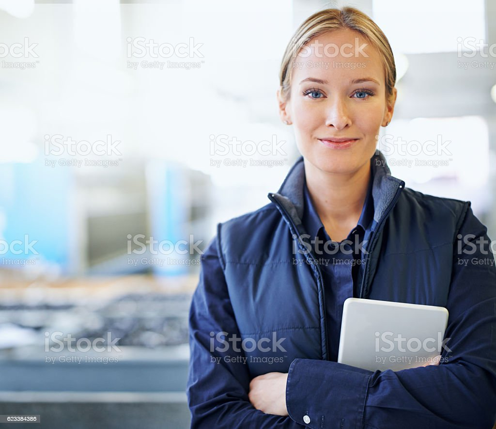 She guarantees quality on the factory floor stock photo
