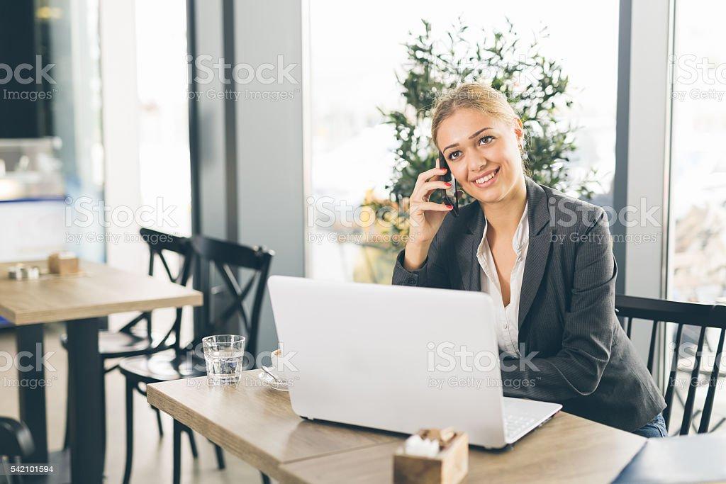 She has a busy coffee break stock photo