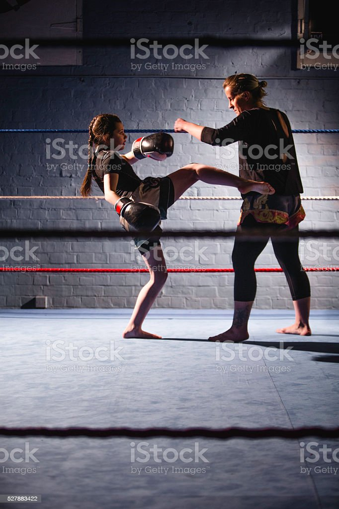 She has a good strong kick stock photo