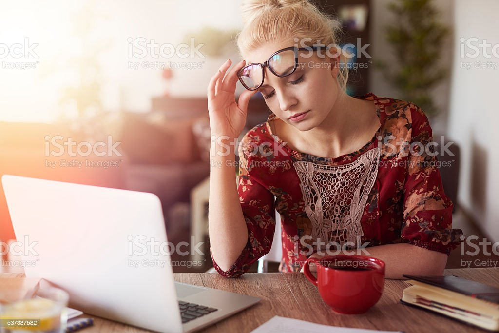 She has too much work recently stock photo