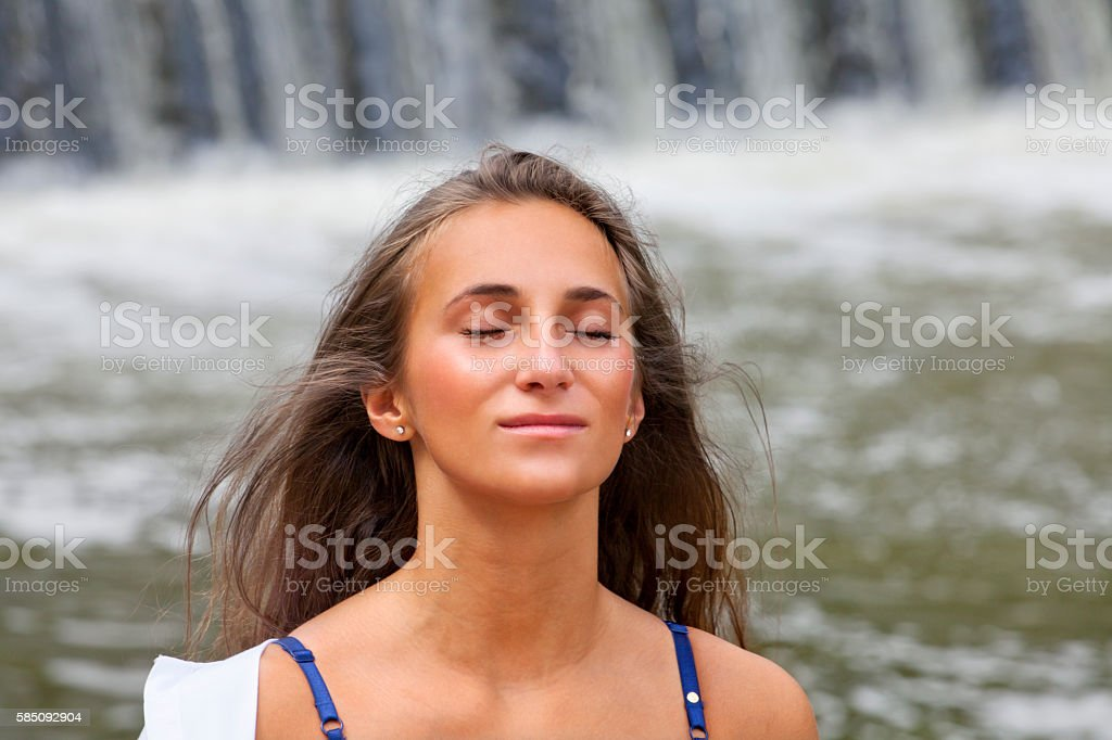 She hears flowing water stock photo