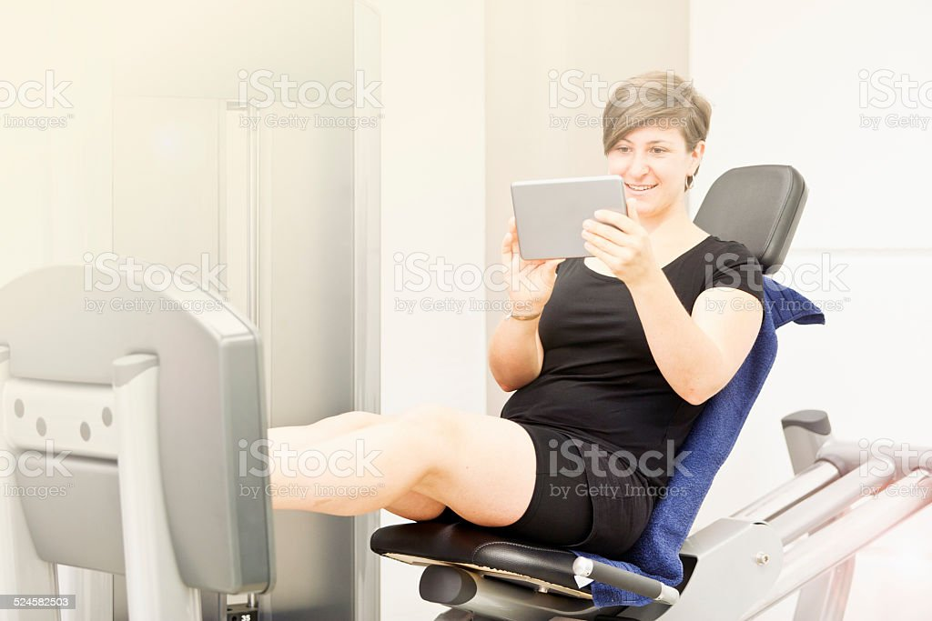She his checking her trainingsplan on a tablet PC stock photo