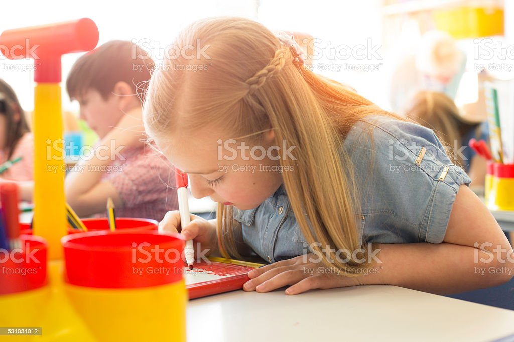 She is concentrating on her classwork stock photo