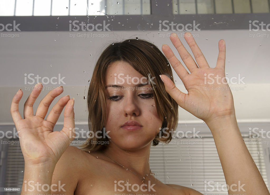 she is waiting behind the glass royalty-free stock photo