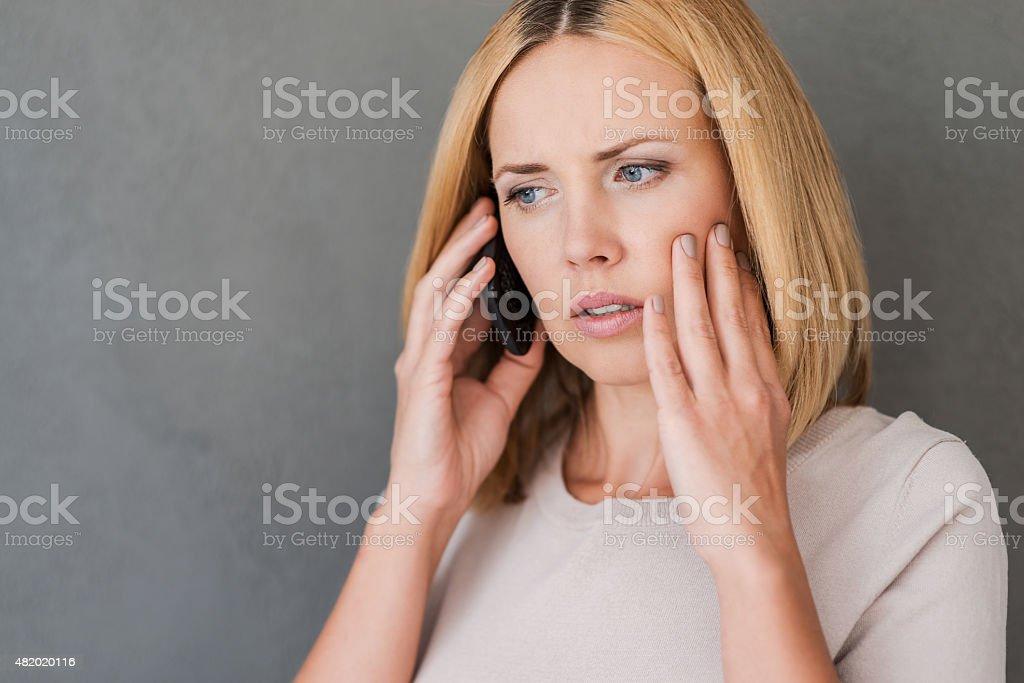 She just got bad news. stock photo