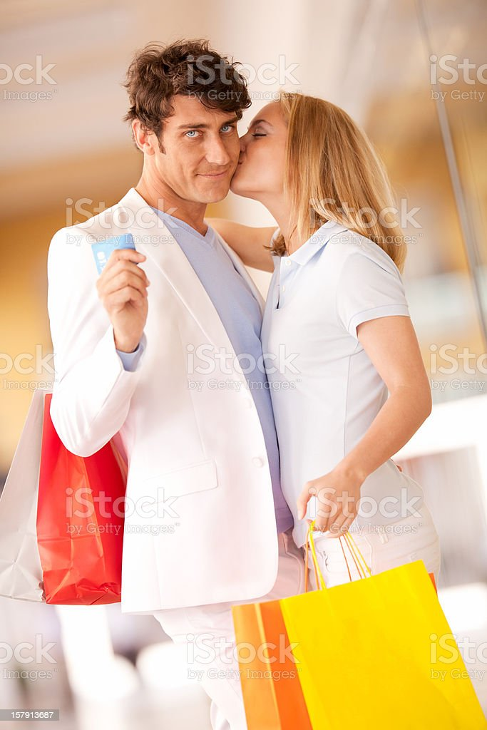 She kisses him after shopping expedition royalty-free stock photo
