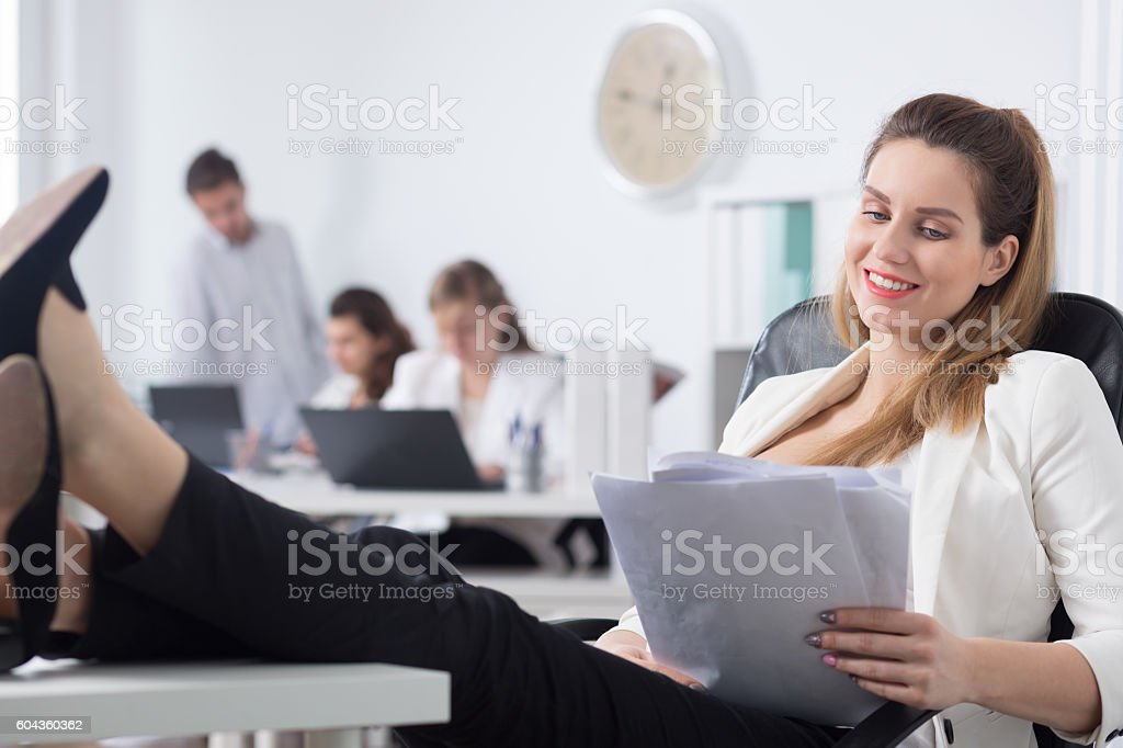 She knows how to survive stress at work stock photo