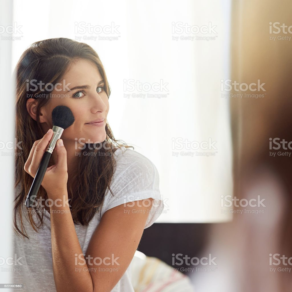 She knows what makeup looks good on her stock photo