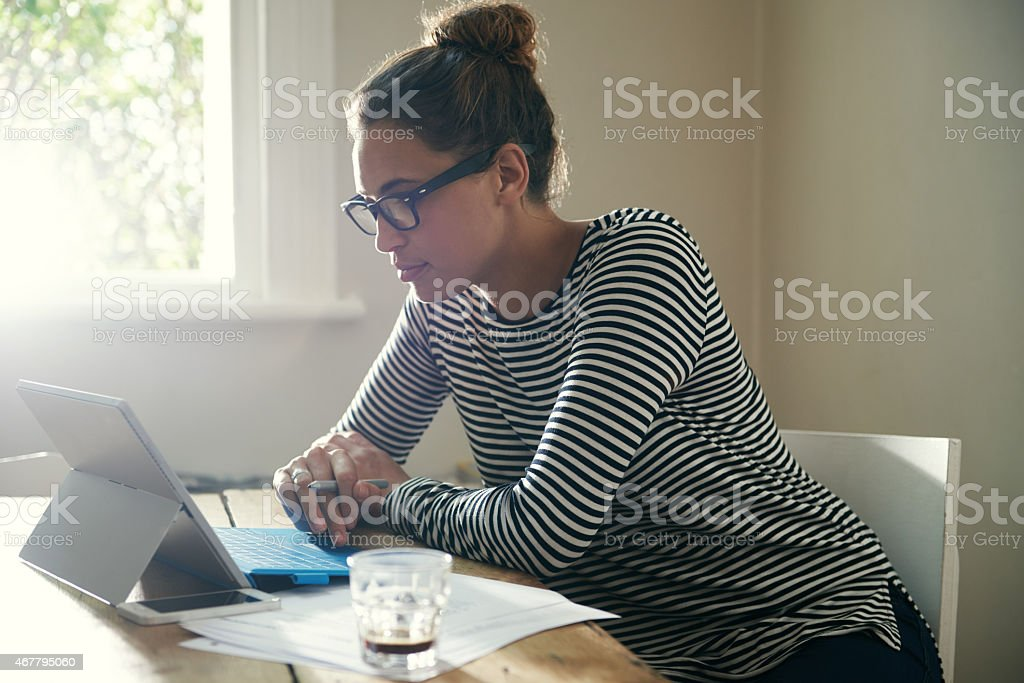 She learns something new everyday with the help of technology stock photo