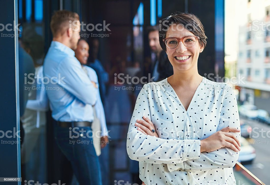 She loves being a part of the team stock photo