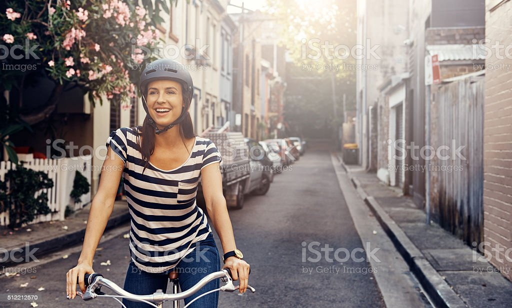 She loves cycling through the city stock photo