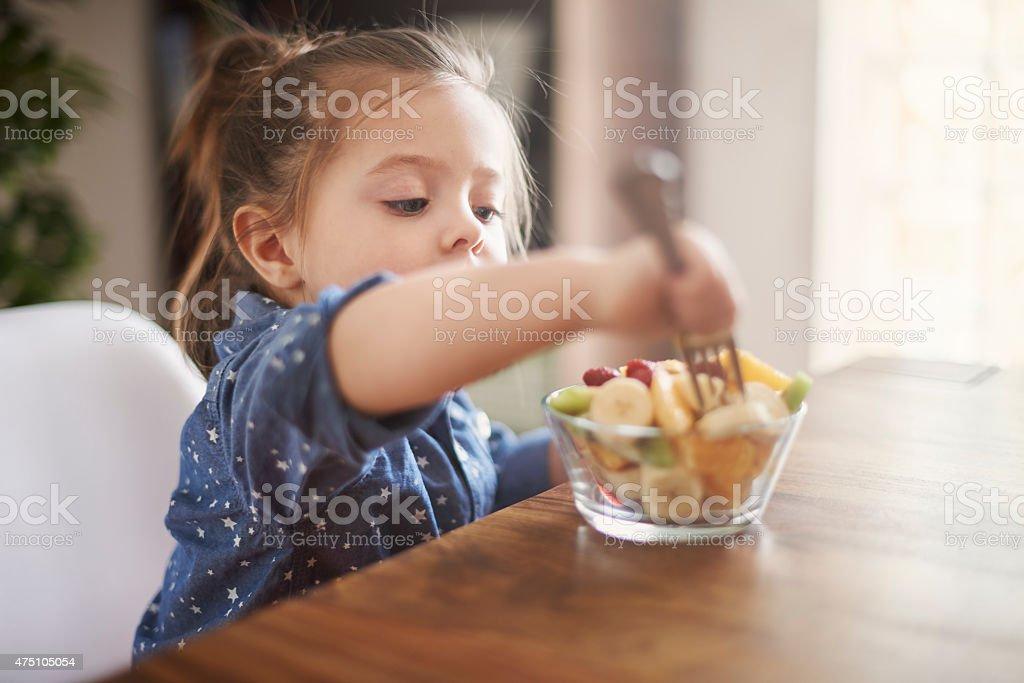 She loves eat fresh fruit stock photo