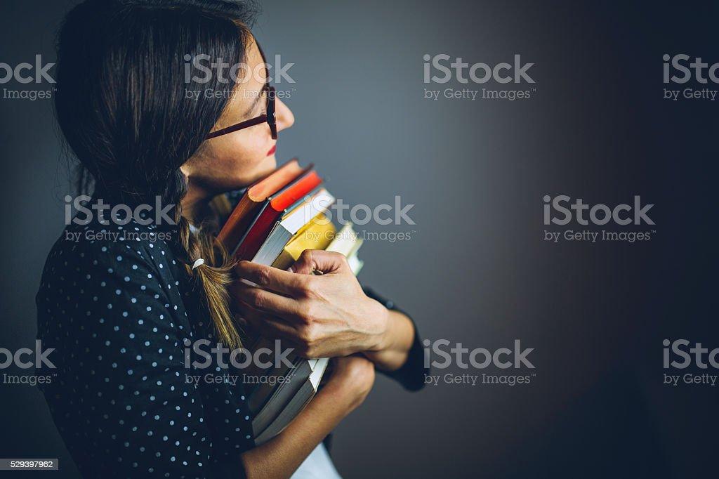 She loves her books! stock photo
