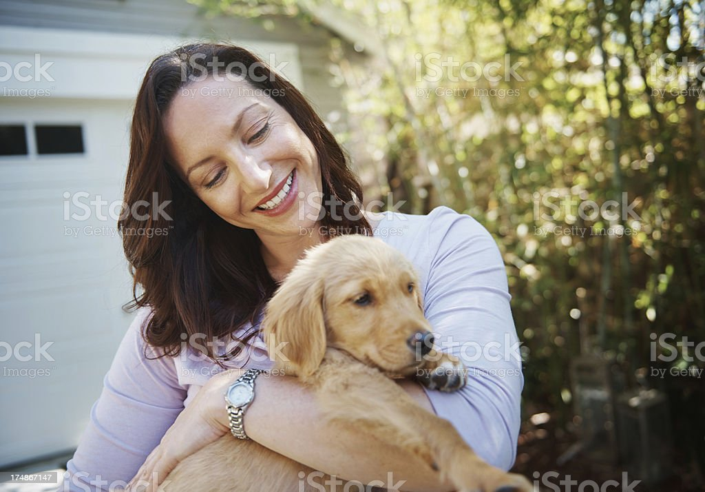 She loves her puppy royalty-free stock photo