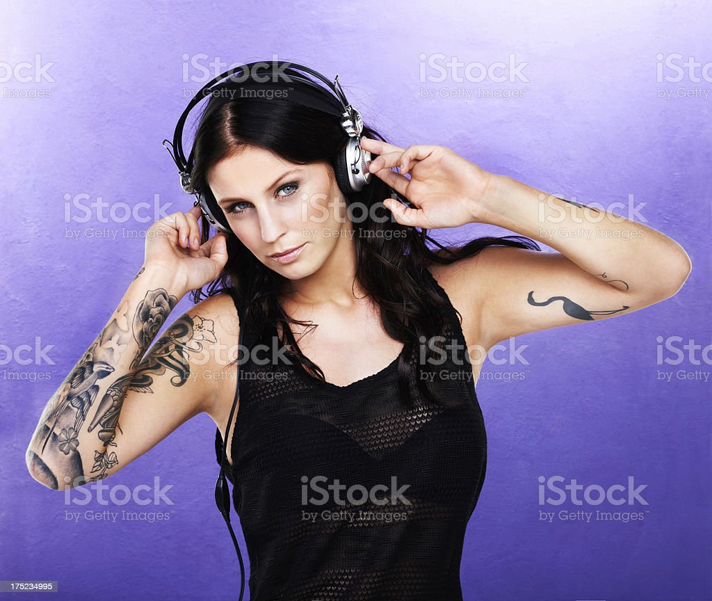 She loves music royalty-free stock photo