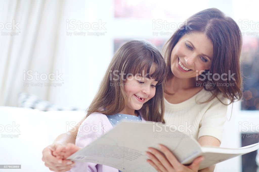 She loves reading about princesses stock photo