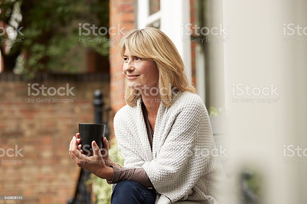 She loves the quiet of morning stock photo