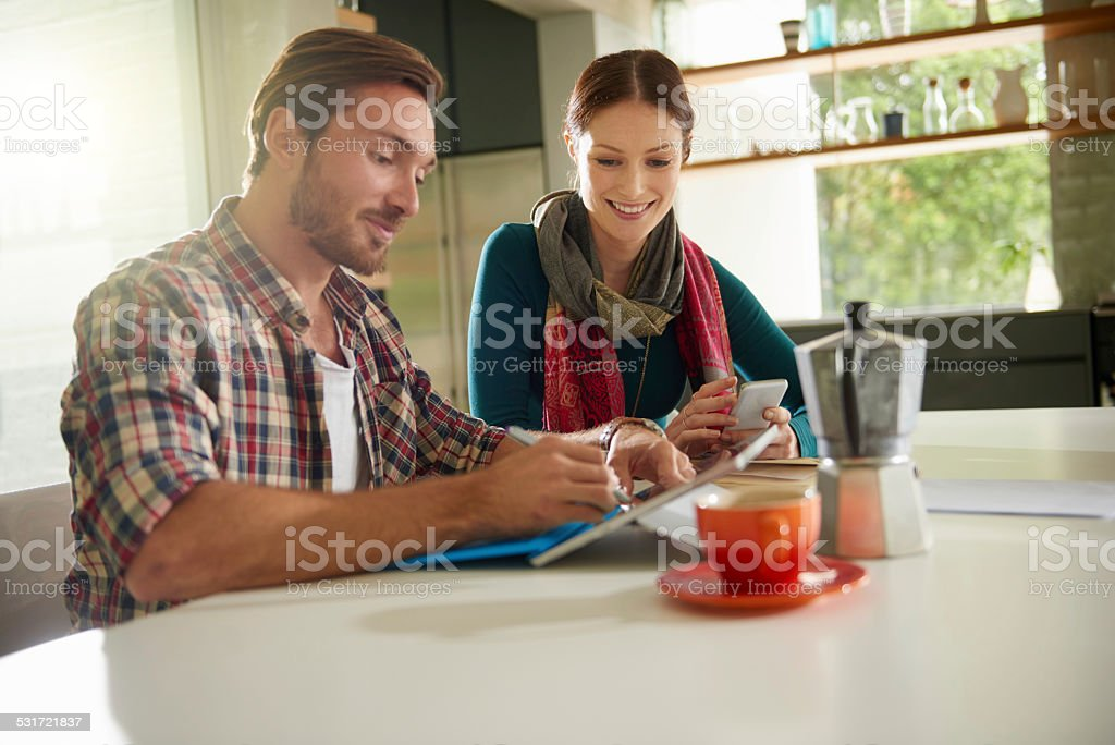 She loves watching him work stock photo