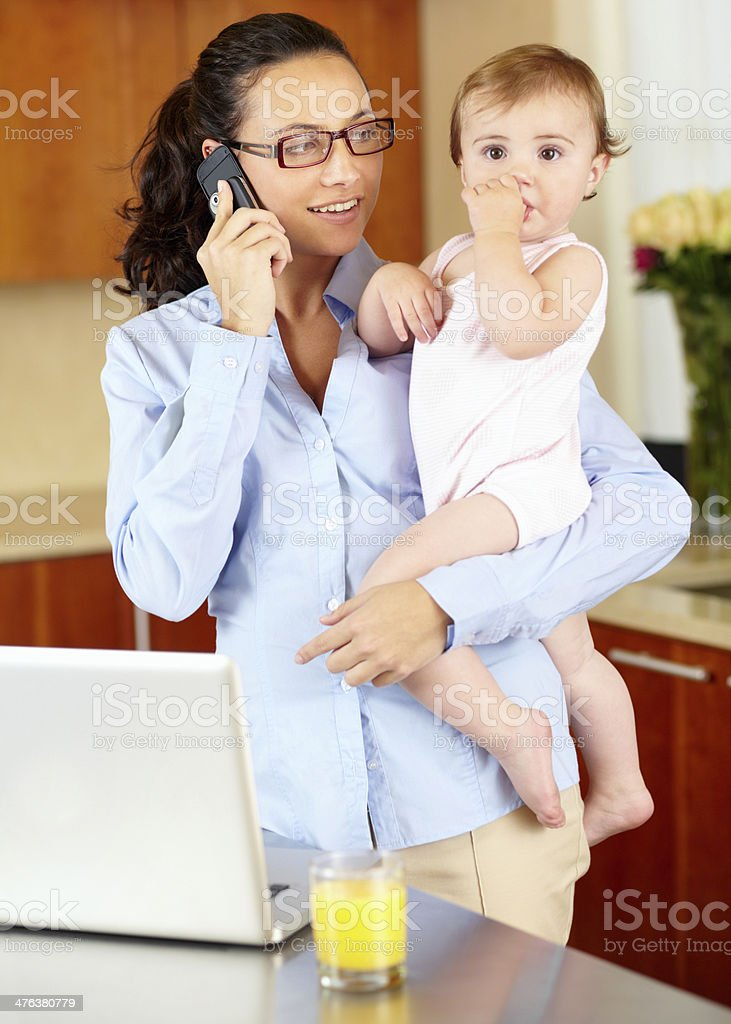 She makes balancing work and home look easy royalty-free stock photo