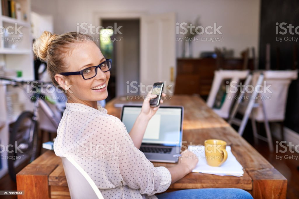 She makes multi-tasking look easy stock photo