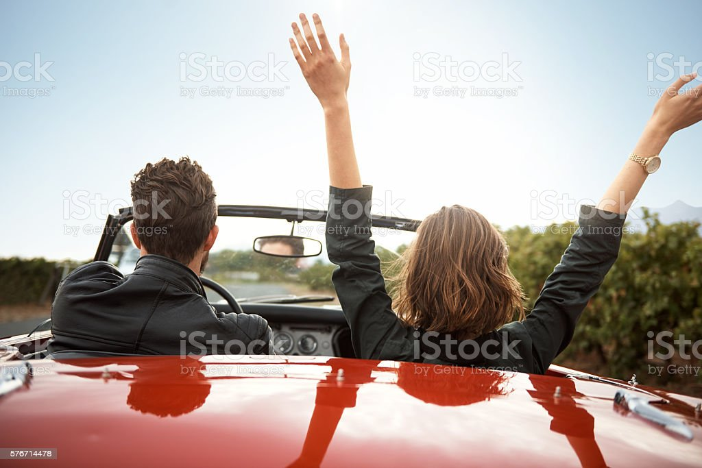 She makes this road trip exciting stock photo
