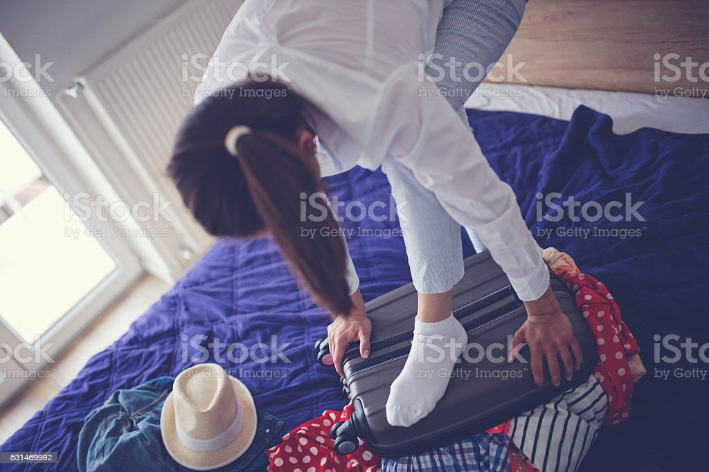 She needs help packing stock photo