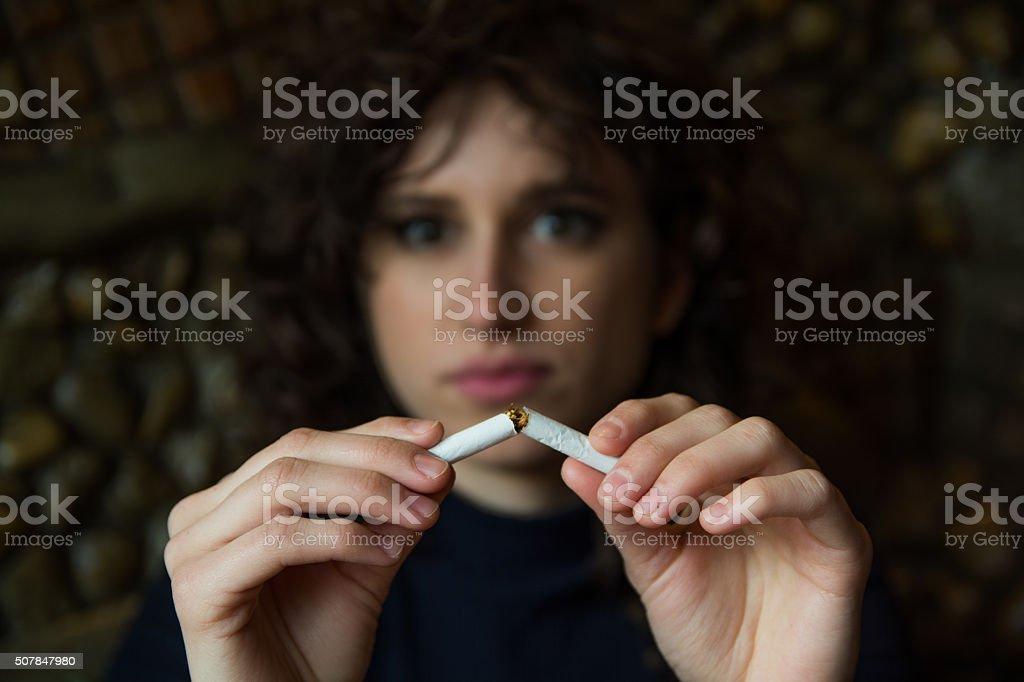 She stopped smoking stock photo
