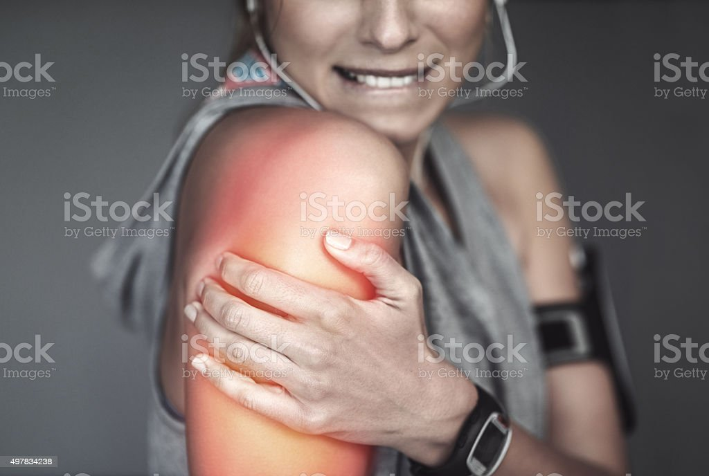 She strained her shoulder with that workout stock photo