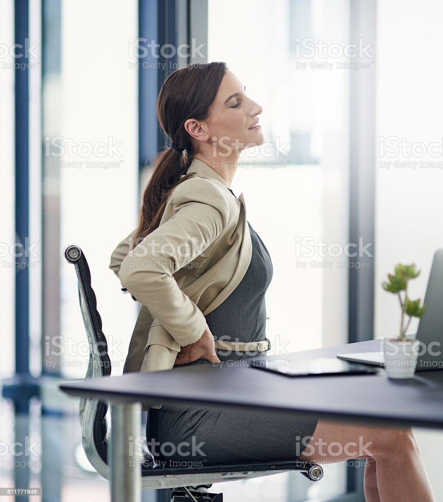 She supports career growth but is she supporting her back? stock photo