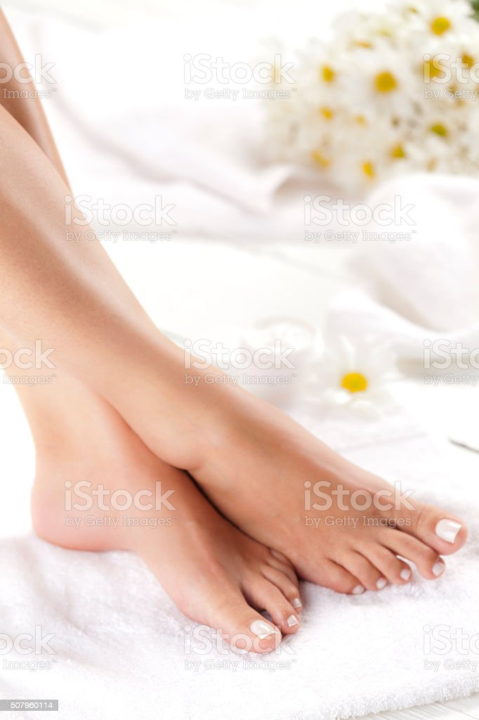 She take care of her feet stock photo