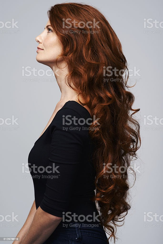 She takes care of her hair stock photo