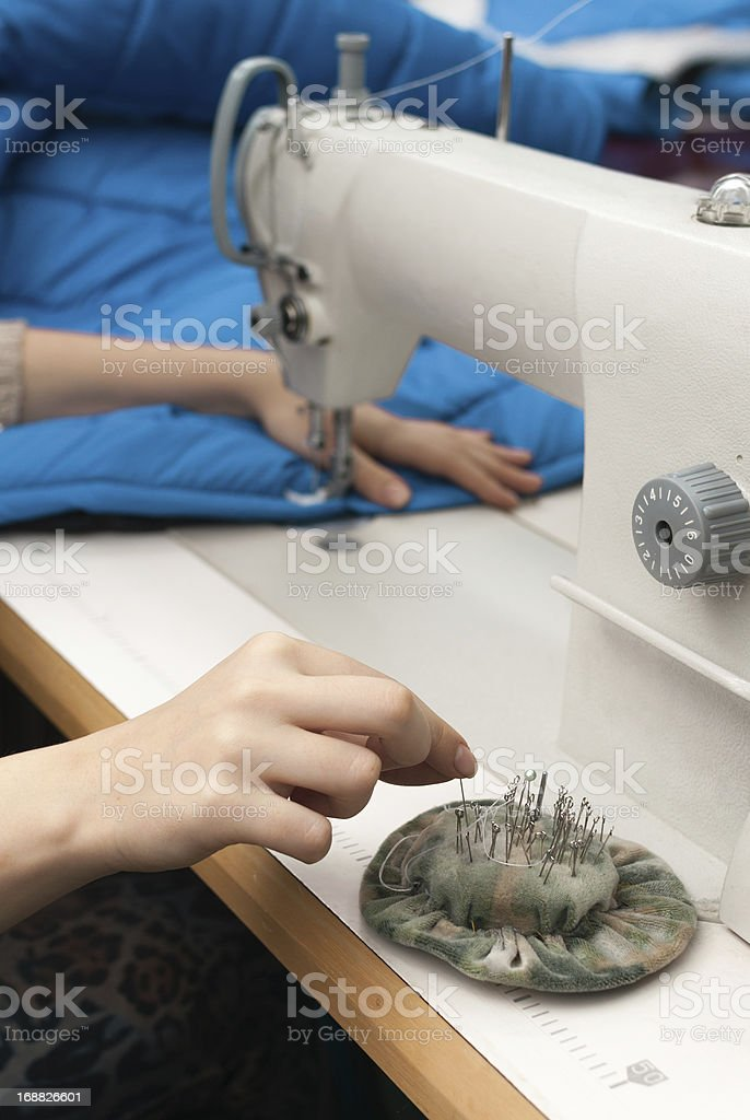 she takes pins with pads and sew royalty-free stock photo