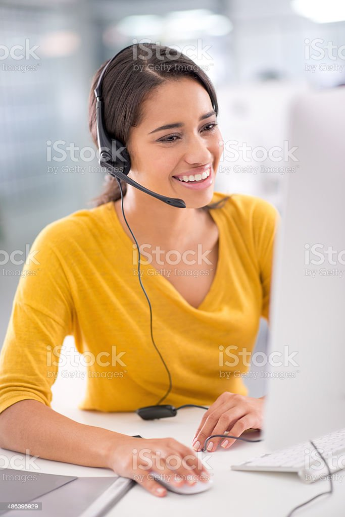 She tries her best to meet the customers' needs stock photo