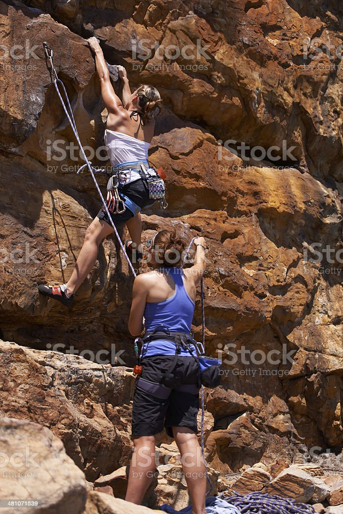 She trusts her belaying partner wholeheartedly royalty-free stock photo