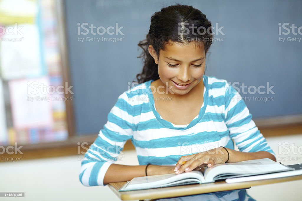 She works hard for her grades stock photo