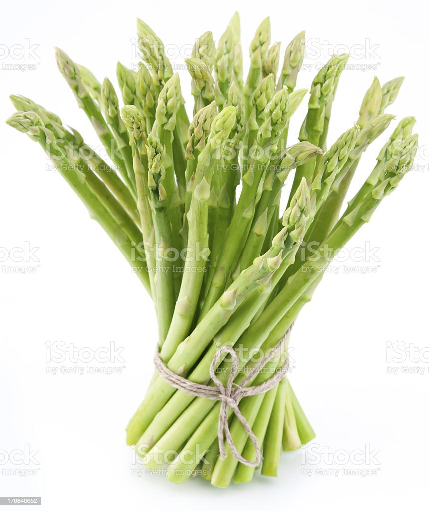 Sheaf of asparagus on a white background. stock photo