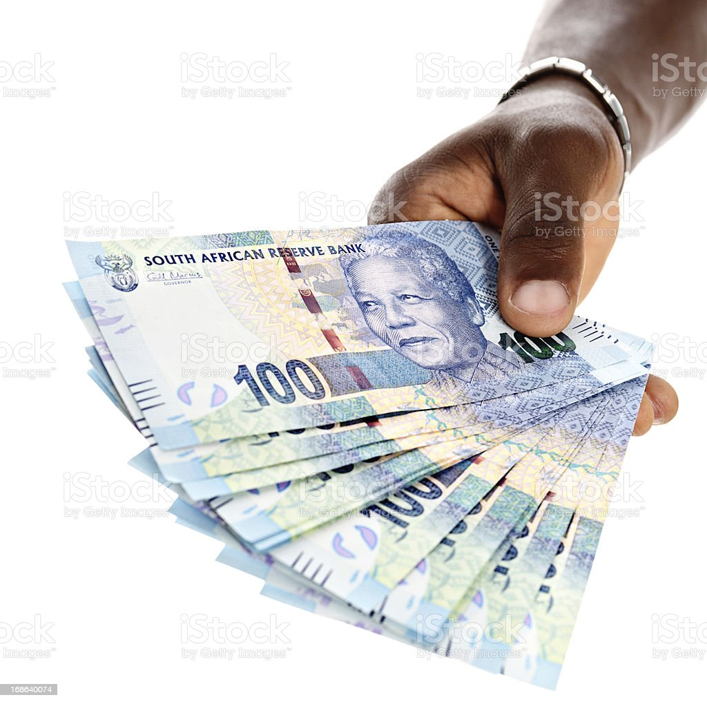 Sheaf of new Mandela Hundred Rand banknotes in male hand stock photo