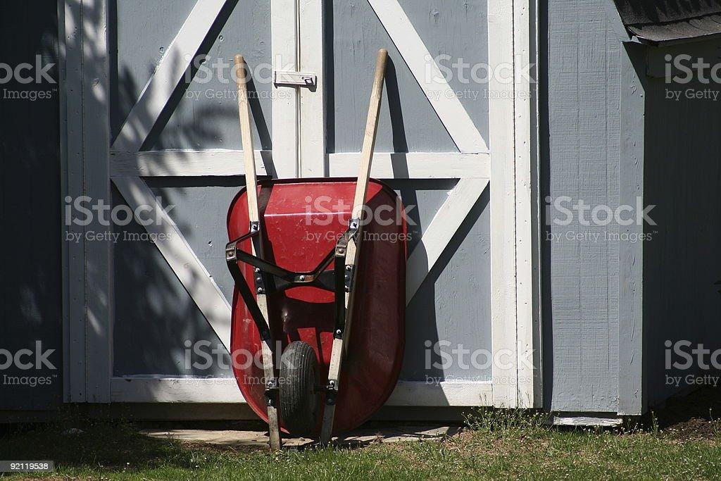 Shed and wheelbarrow stock photo