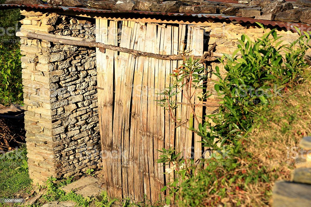 Shed in orchard-evening light. Dhampus-Nepal. 0498 stock photo