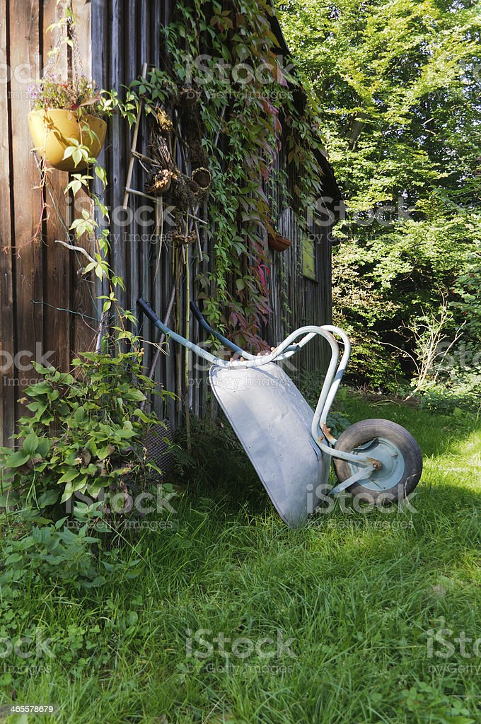 Shed with wheelbarrow royalty-free stock photo