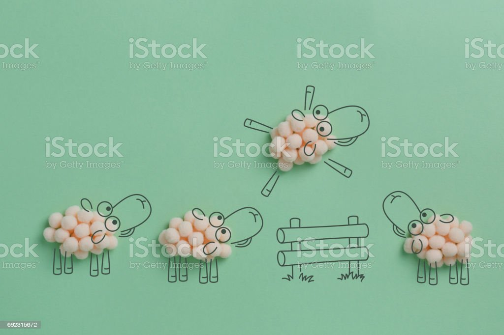 Sheep jumping over the fence. stock photo