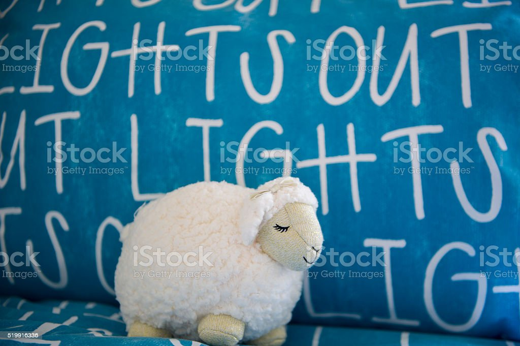 Sheep On Bed With Lights Out Sheets stock photo