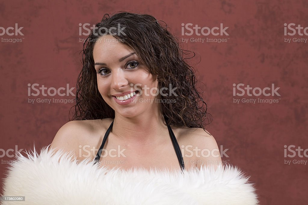 Beautiful model wrapped in sheeps wool smiling.