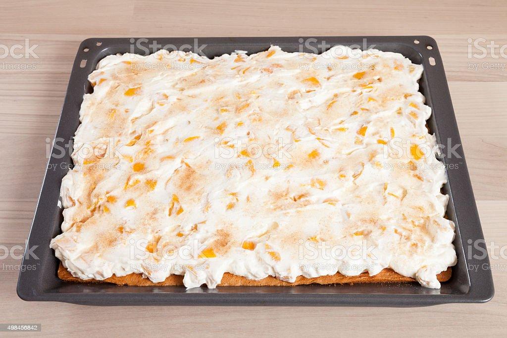 Sheet cake, nectarine cream cake stock photo