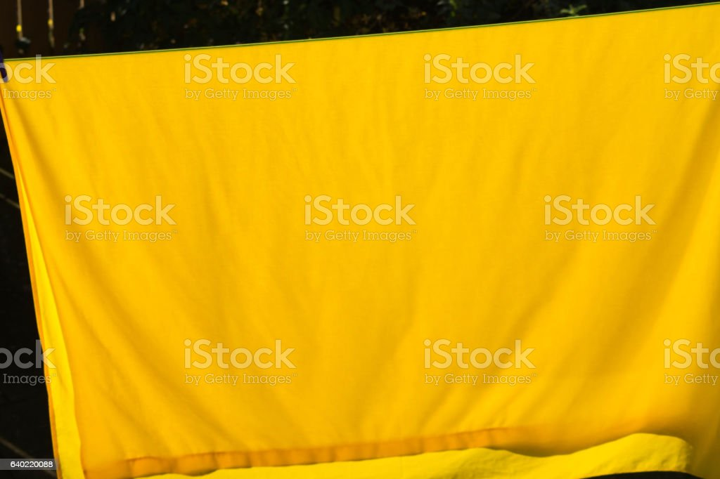 Sheet drying on a clothes line stock photo