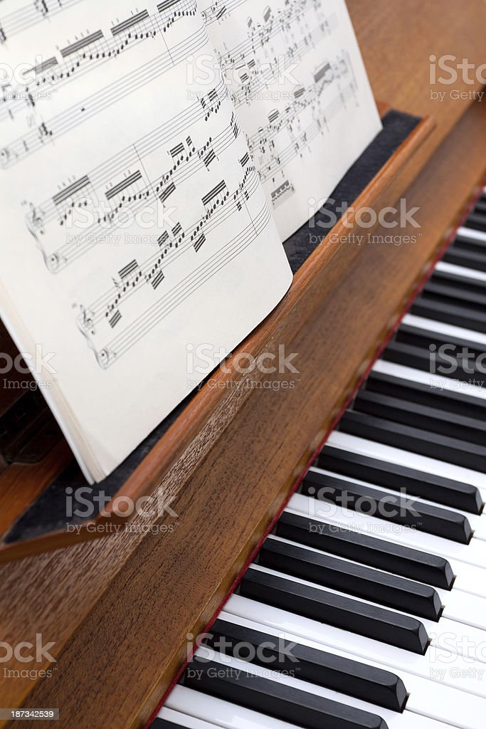 Sheet music and keys of piano royalty-free stock photo