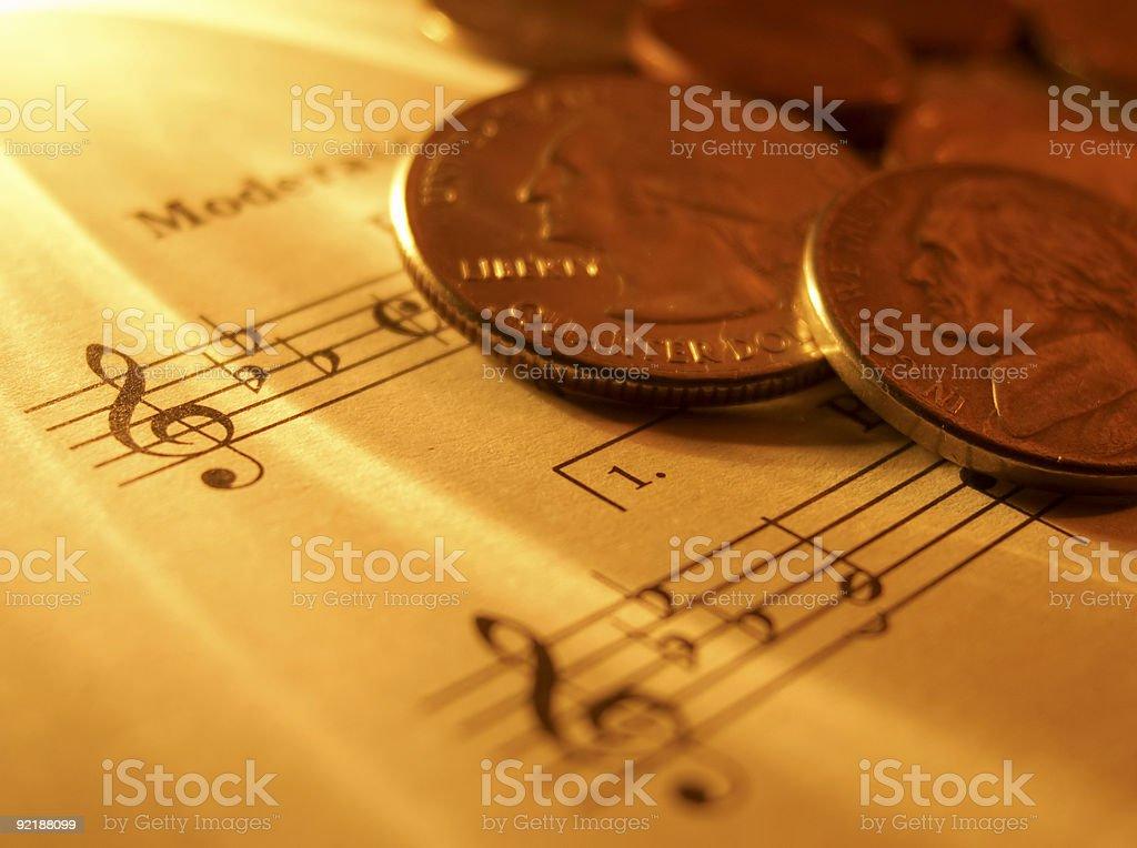 Sheet music and money stock photo